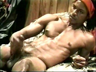Muscular black guy rubbing cock