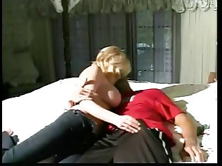 Hot busty coed straddles hung stud and rides his cock on bed