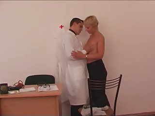 Young doctor and lustful adult patient with hanging tits