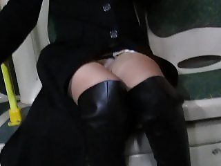 black leather high heel boots and stockings in a bus