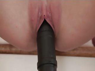 Shaved vagina and huge black dildo