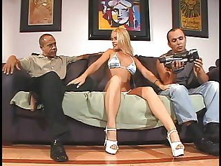 Blond porn star fucking two guys at once