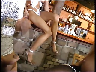 Sexy blonde rides and sucks hard cock in a bar
