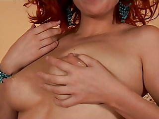 Jugs full of milk on a gorgeous redhead