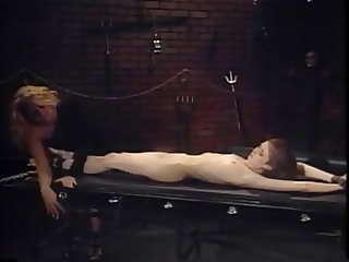 Slim young whore gets fingered and roughened in bondage fantasy