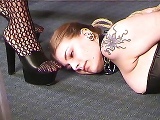 Cute young lesbian brunette in a corset is tortured by her slave mistress