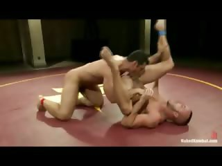 Muscled gay guys fight for the right to dominate and fuck the other