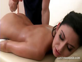 Brunette seductress enjoying a great butt oil massage