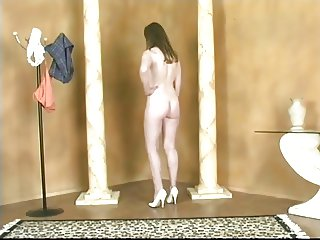 Cute young brunette strips and spreads her pussy lips
