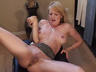 Blonde MILF squirts with huge dildo