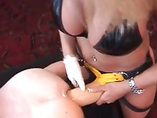 Giant strap-on in ass