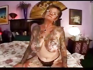 hot sex with tattooed granny