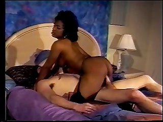 Ebony babe in black lace fucked on bed by fat white cock