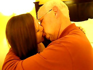 Hot Woman kissing a 82 year old man