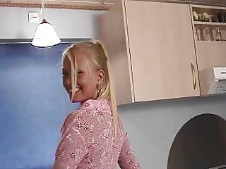 Blonde play with herself in the kitchen