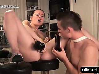 Horny tramp gets cunt dildo nailed in kitchen
