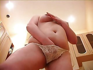 Chubby is masturbating in kitchen
