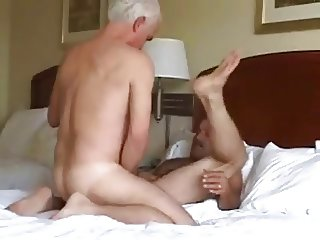 Two energetic mature men in a hotel.