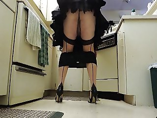 Sissy Ray in Black Maid Skirt and red blouse