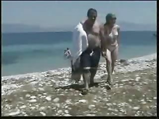 Daddies and girl on the beach
