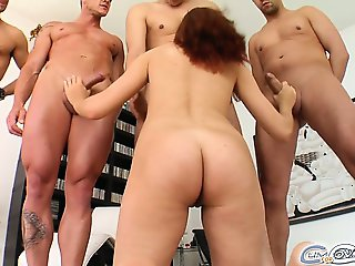 Lia absolutely loves to suck dick. She polishes off four ready to rock cocks. They blast their big loads all over her innocent face
