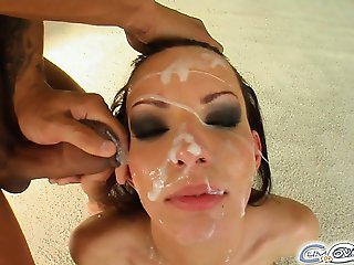 A cute skinny brunette sucks off four guys. They shove their cocks deep down her throat and plaster her face full of sperm