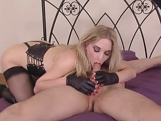 Superior looking Mistress ties slave for sexual encounter