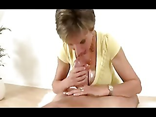 Mom with big boobs jerking dick at oil & suck a dick