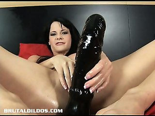 Hungarian beauty Aliz fills her pussy with a huge dildo