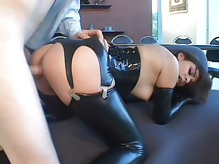 Rubber fetish girl takes it in the ass