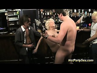 blonde busty slut is the main attraction of the bar