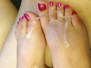 Wife gives footjob with exploding cumshot