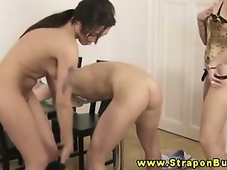 Femdoms strip their sub down before pegging him