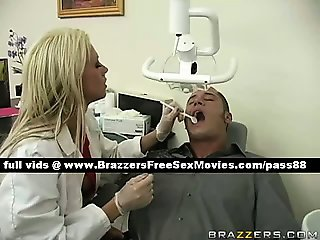 Gorgeousblonde dentist looks at a pacient mouth