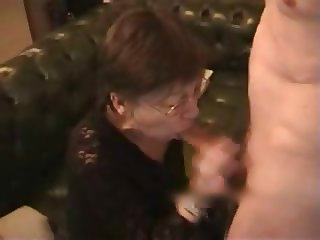 Older wife receives cum on face and chest