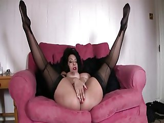 British MILF Danica plays with herself on the sofa