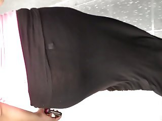 Fat ass Mexican in see thru black skirt