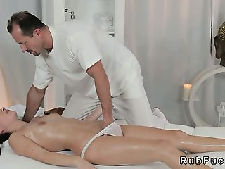 Hot bum brunette gets oiled and fucked on massage table