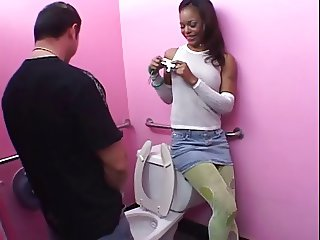 In bathroom with ebony girl