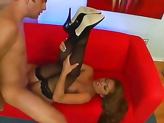 Guy fucking an Asian slut in stockings and heels