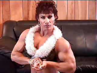 muscle girl Stripping in Living Room