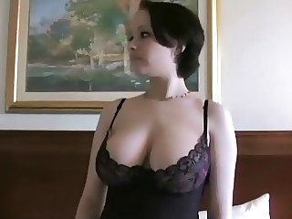 Short haired brunette with massive boobs, strips off.