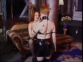 Two leather dominas lick each other's twats