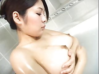 Big tit Asian taking bath
