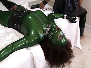 Latex Sex Slave in Green Catsuit