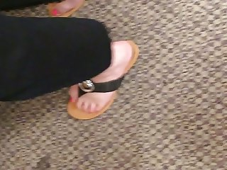 Wife's sexy feet cute and sexy shoes at the register