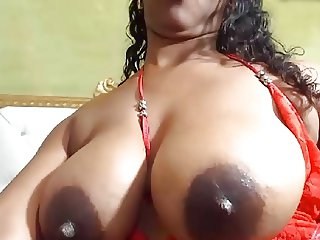 Big black tits with milk played with