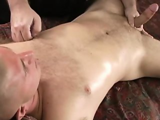 Muscle jock gets his rod tantalized