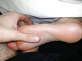 Quick footjob while my gf is in bed