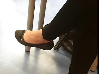 Student Ballerina shoes barefeet dangling